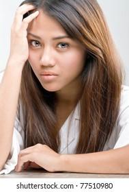 Close-up portraits of young pretty Asian woman with stress look