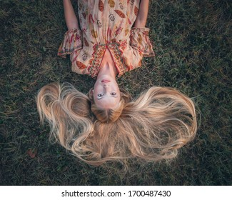 Closeup portrat of a young beautiful teenager woman posing in front of the camera. Model wearing stylish summer dress/clothes.Girl looking at camera.Female fashion.Sunny day. City lifestyle.Waist up.  - Shutterstock ID 1700487430