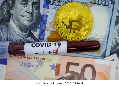 Closeup of positive covid-19 blood sample tube on top of dollars euro banknotes and bitcoin token. Financial Crisis Economic Stock Market Banking Concept due to new pandemic outbreak