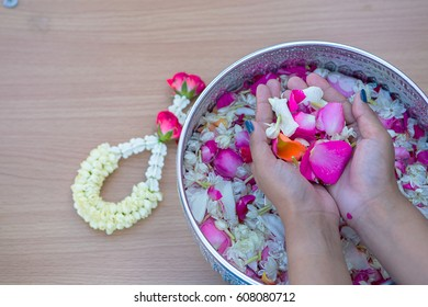 Close-up Pour water on the hands of revered elders and gives blessing in Songkran day Thailand