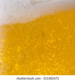 closeup from a Pouring beer with froth