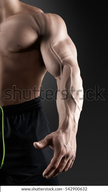 Close-up of a power fitness man's hand.