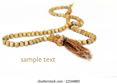 close-up of prayer beads against white background