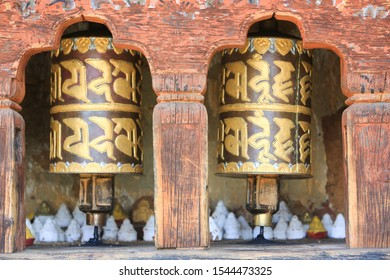 Close-up of prayer wheels with tsa-tsa offerings in a Buddhist temple in Paro, Bhutan. Tsa-tsa memorial cones are small stupa-like offerings made of clay or from the ashes of the dead relative.