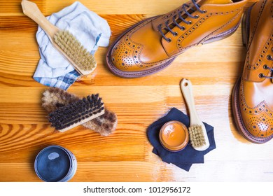 Close-up of Premium Tan Brogue Leather Boot with Set of Cleaning Accessories,Wax  and Cloth. Horizontal Shot