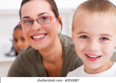 closeup of preschool boy and teacher