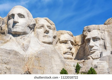 Closeup of presidential sculpture at Mount Rushmore national memorial, USA. Blue sky background.