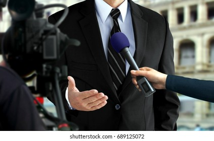 Close-up press interview with a man in black suit