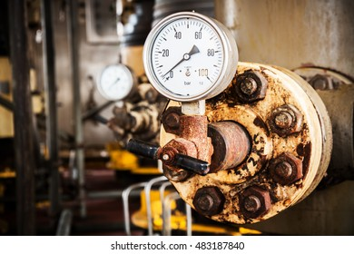 Closeup of pressure gauge , pressure gauge measuring gas pressure. Pipes and valves at oil and gas industrial plant.