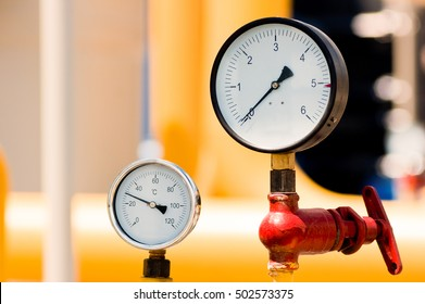 Closeup of pressure meter on natural gas pipeline