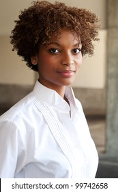 closeup of pretty African American executive standing outside