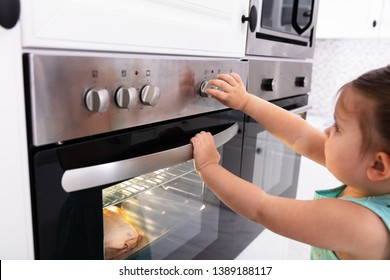 Close-up Of A Pretty Girl Adjusting Temperature Of Microwave Oven