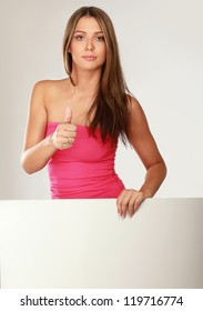 Close-up of pretty woman showing thumb up isolated on white background