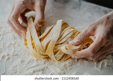 Closeup of process of making cooking homemade pasta. Chef make fresh italian traditional pasta