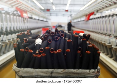Close-up of the produced threads against the background of the production line. Factory for the production of threads and fabrics