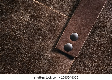 Closeup of a product made out of real brown leather.