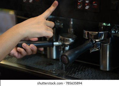 Close-Up of professional coffee machine making a cup of coffee. It's coffeemakers or coffee machines are cooking appliances used to coffee