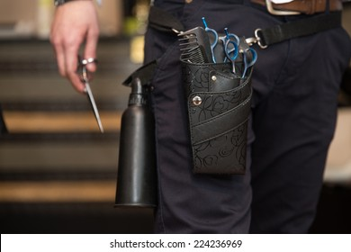 Close-Up Of Professional Equipment Tools Accessories Of Hairdresser - Tools Of A Professional Hairdresser Neatly Stored In A Leather Belt And Pouch Worn Around His Waist In The Hair Salon