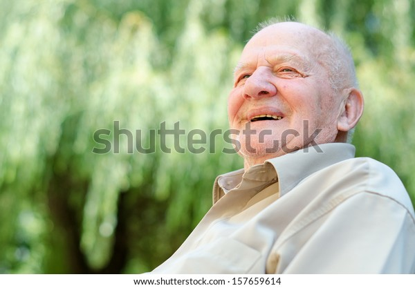 Closeup profile on a smiling old man