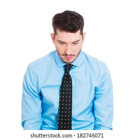 Closeup profile portrait of sad bothered stressed serious young man, looking down, depressed about something or someone, isolated white background. Negative human emotion facial expression feeling