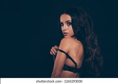Close-up profile side view portrait of nice sweet tender delicate lovely feminine alluring attractive wavy-haired lady putting swordbelt off posing teasing isolated over dark black background