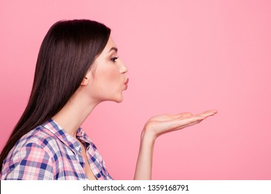 Close-up profile side view portrait of her she nice-looking attractive cute charming lovely sweet lovable straight-haired lady sending kiss to boyfriend isolated over pink pastel background