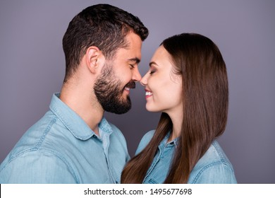 Close-up profile side view portrait of two her she his he nice attractive charming lovely lovable careful gentle sweet tender cheerful cheery person cuddling isolated over gray pastel background