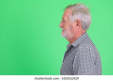 Closeup profile view of handsome senior bearded man