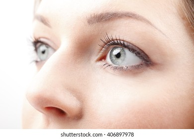 Close-up profile view of an woman eye. Isolated on white background.