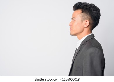 Closeup profile view of young Asian businessman in suit