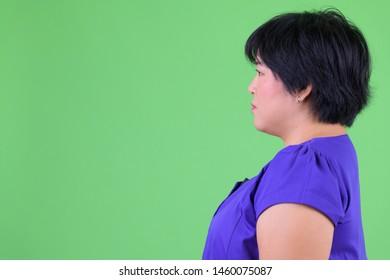 Closeup profile view of young beautiful overweight Asian woman
