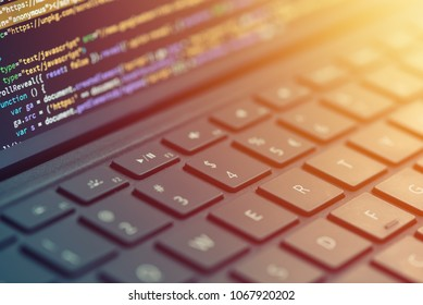 Closeup programmer coding on screen. Hands coding html and programming on laptop screen, web development, developerCloseup coding, programming on laptop screen, web development, developer