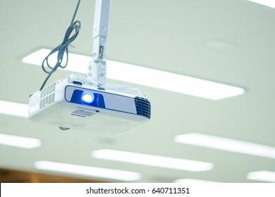 Closeup of projector for presentation on office, LCD video projector at business conference or lecture with copy space