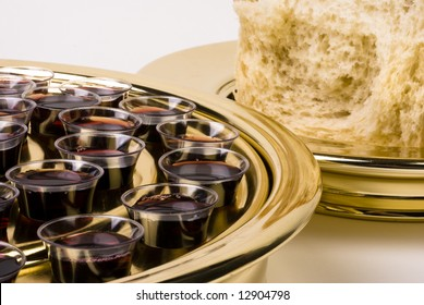 Close-up of a Protestant style communion tray with wine glasses and a plate with bread.