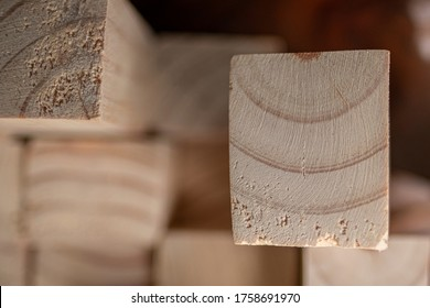 Close-up of protruding sawn rectangular wooden pine blocks. The wood fiber is stands out and very good. In Indonesia known as kayu Jati Belanda or kayu Pinus.