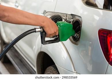 Closeup of pumping gasoline fuel into car tank
