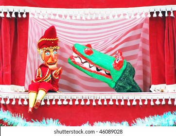 Closeup of puppets showing punch and crocodile.