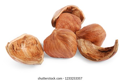 Closeup of purified hazelnuts and shells, isolated on the white background, clipping path included. Full depth of field.