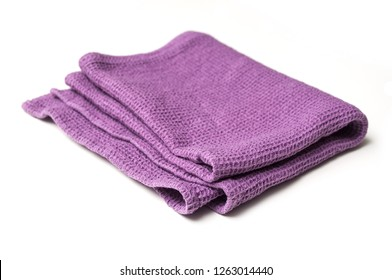 closeup of purple cleaning towel on white background