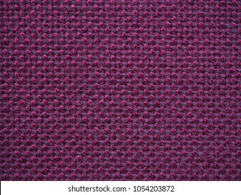 Close-up of the purple textile texture, background and wallpaper. The texture of purple fabric textile upholstery of furniture. High-quality macro photography.