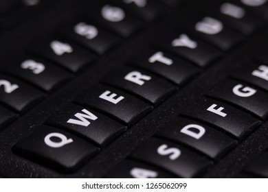 Closeup of QWERTY keys on keypad