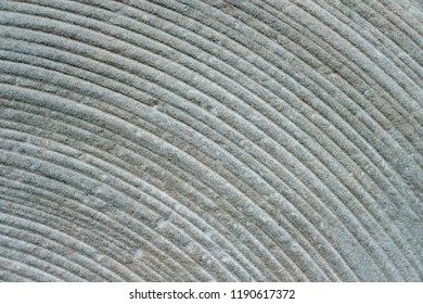 closeup of radial millstone grooves