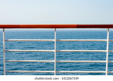 Closeup of railing on ship with view to ocean. railing on the cruise with sea in background.