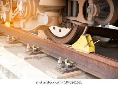 closeup railway brake under a train wheel