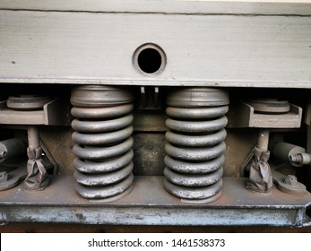 closeup of railway engine huge and powerful suspension steel springs in grey colour