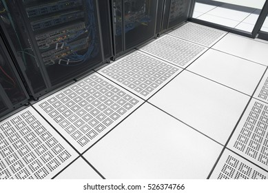 Closeup raised floor in modern interior of server room in datacenter with empty area for text.