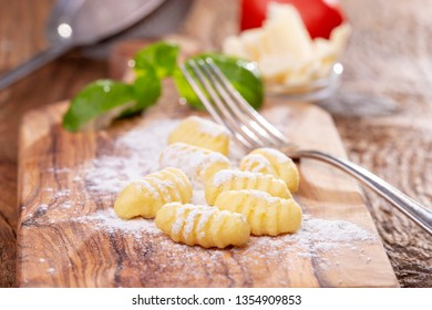 closeup of raw gnocchi on wood