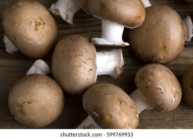 Closeup of raw mushrooms on wooden background