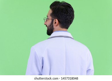 Closeup rear view of happy young bearded Persian man doctor smiling
