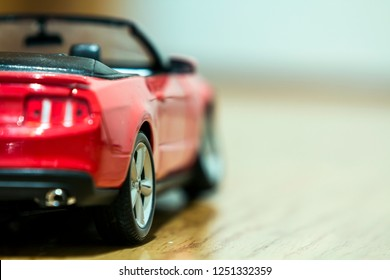Close-up of rear view of red toy car